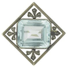 A Fabergé jeweled aquamarine brooch, workmaster August Hollming, St. Petersburg, 1898-1908, the rectangular amethyst within rose-cut diamond set floral sprigs, within a fluted frame, struck with workmaster's initials and 56 standard, with scratched inventory number 96671 or 96871