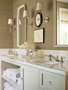 Simple and Streamlined: double vanity with open storage between sinks for towels, etc.