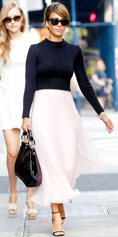 Alba headed to the Ralph Lauren spring/summer 2014 show in pretty pale pink midi skirt, a black long-sleeve knit sweater and black accessories, all by the designer. Jewelry wise, she wore Jamie Wolf earrings and an EF Collection ring.