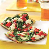 Goat Cheese-Spinach Pizza | http://www.rachaelraymag.com/Recipes/rachael-ray-magazine-recipe-search/five-ingredient-recipes/goat-cheese-spinach-pizza