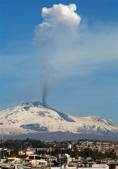Mount Etna is seen from the city of Catania as it spews lava and smoke on the southern Italian island of Sicily March 18, 2012.