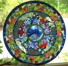 Beautiful mix of hand blown and dichroic glass.....outstanding!