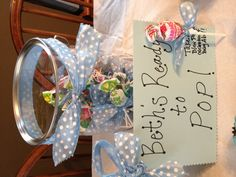 """Ready to """"pop"""" blow-pops tied with blue ribbon bow ties for a boy baby shower"""