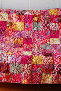 Love the colors and fabrics in this baby quilt.  I swear, one of these days, I am going to stop pinning quilts and actually try to make one.