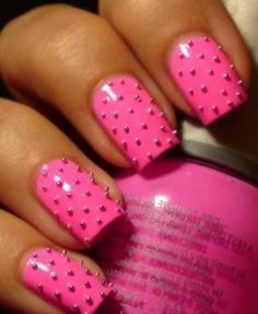 love the pink nails with the polka dots(=