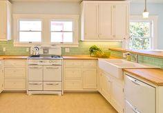 chrome handles for stove, butcher block, floor, tile color on something else