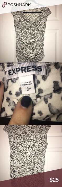 Express Leopard Tee Size L, white and black leopard tee from express. Tee is semi sheer and has slight cowl neck for some added interest. Seams feature size ruching, Very fun and flirty top! No rips or stains. Express Tops Tees - Short Sleeve
