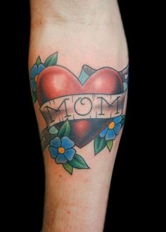 A simple heart tattoo inked on the skin in loving memory of a mother. easily noted is the colorful nature of the design. light blue inking for the petals, Tribal Tattoos, Side Tattoos, Mom Tattoos, Sleeve Tattoos, Tattoos For Guys, Rip Tattoo, Simple Heart Tattoos, Unique Tattoos, Tattoos For Women Small