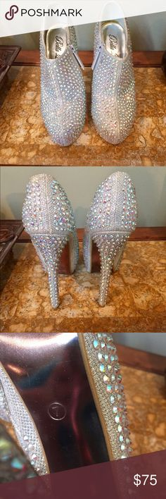 Rhinestone studded platform heals 💗🎉👠 Stand out with these Sparkle Jewel Rhinestone Studded High Stiletto Platform Pumps ! Size 7 ! Color-Silver ..Happy Poshing 🎉🎉👠 Shoes Heels