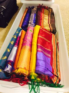Great way to store all my Indian Sarees! Under the bed 41 qt containers are just the perfect size!
