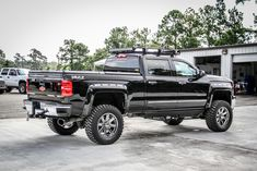 A lifted Chevy Silverado 2500 HD Crew Cab with bed sports a roof rack, fender flares, and black DiamondBack 270 truck bed cover. Chevy High Country, Chevy Silverado High Country, 2016 Chevy Silverado, Chevy Silverado 2500, 2014 Chevy, Lifted Cars, Lifted Chevy, New Trucks, Cool Trucks