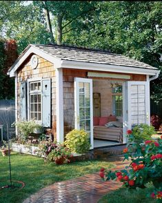 The Quaint Escape: With a cozy daybed and French doors that swing open to a charming and lush garden, this she-shed is the ultimate spot for whiling away a summer afternoon. house 17 Charming She-Sheds to Inspire Your Own Backyard Getaway Backyard Storage Sheds, Backyard Sheds, Outdoor Sheds, Shed Storage, Garden Sheds, Diy Storage, Storage Ideas, Backyard Studio, Backyard Office