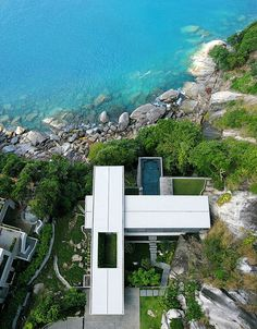 Amanzi Located in Phuket, Thailand, Villa Amanzi combines the best of contemporary design and ultra modern architecture to create a sublime cliff-side sanctuary. Built into the granite rock face, Amanzi features panoramic views of theAndaman Sea, an open-plan living area that stretches from the garden entrance to to the infinity pool, and even it's own mountain stream.