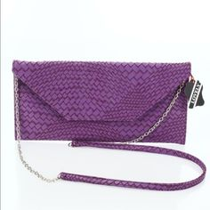 """Purple Woven Cross Body Bag Envelope style, woven look, detachable strap, with inside zipper pocket and two open cell phone pockets. Magnetic snap closure. 5.5"""" X 11.25"""" X .25"""". No Trades. Make offer with offer button. Bags Crossbody Bags"""