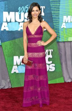 Jenna Dewan Tatum 2015 CMT awards in a magenta Zuhair Murad dress laced with peekaboo panels, plus Tamara Mellon sandals, an oxblood clutch, deep purple danglers, and two cocktail rings.
