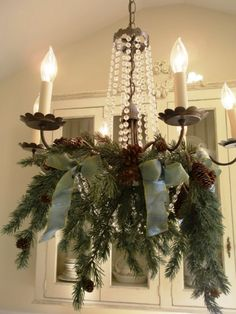 Faux greenery, pinecones and beautiful ribbon - remember inner entry and old kitchen one fauxed up in bathroom