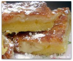 LEMON GOOEY BARS: (Easy Cake)Crust: 1 lemon cake mix 1/2 cup butter, melted 1 egg Filling: 1 Tablespoon Vanilla extract 2 eggs 8 ounces of cream cheese, at room temperature 1/2 cup butter, melted 3 3/4 cup powdered sugar *If desired, you can add the zest of one lemon, or a 1/2 tsp of dried lemon zest. This will make the bars more tart