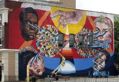 Artists adorning buildings in Richmond Mural Project
