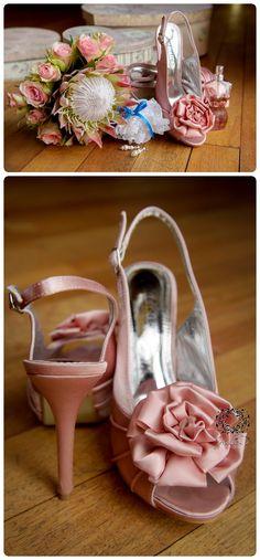 wedding photographer; wedding shoes, pink wedding shoes, pink wedding heels. big pink rose on wedding shoe