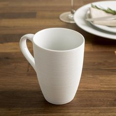 These simple white porcelain cups are perfect for any decor. Durable porcelain construction is dishwasher safe and great for everyday family meals or special occasions.