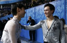 Hanyu speaks with Chan before the flower ceremony during the Figure Skating Men's Free Skating Program at the Sochi 2014 Winter Olympics