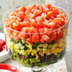Layered Garden Bean Salad Recipe from Taste of Home |  Perfect for entertaining, this recipe can turn it into a light lunch by adding sliced rotisserie chicken, salmon or tuna.