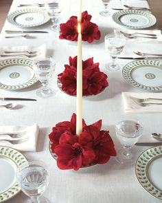 With the help of these candle and flower centerpieces, the whole table will shine.For each one, use candle wax to attach a small floral frog to the center of a shallow bowl. Push a taper into the floral frog to secure. Pour water into the bowl. Clip amaryllis blooms (or other large flowers) from their stems, and arrange them in the bowl around the candle.