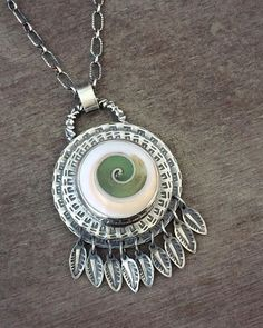 @proxartist  Finished.  This lovely swirly is a Fossilized shell!