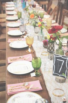 Boho wedding reception, vintage china, colorful stemware and gold flatware from Southern Vintage rental