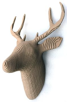 Cardboard Deer Head, Whitetail, hand made to order but usually have one in stock. Approximately 350mm high 270mm wide and 160mm deep. You have the option to purchase this already glued together Assembled or Unassembled where youll need to put it together yourself. I include instructions, tips and a video of where each part goes. Made from 3mm thick laser cut cardboard, looks great mounted on the wall, seen from some angles it looks transparent Please get in touch if you have any questions.