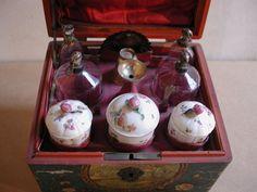 Nécessaire à parfum avec médaillon (Perfume Kit), 2nd half of the 18thC, France, wooden box and vernis Martin, gilt silver utensils, porcelain and glass. Les Arts Decoratifs