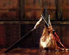 Pyramid head is a fictional character from the Silent Hill series of survival horror games. His most noticable feature is the big triangle which completely covers his head, aswell as his weapon, the Great Knife. Silent Hill 2006, Silent Hill Movies, Silent Hill Game, Red Pyramid, Pyramid Head, Silent Hill Wallpaper, Saga, Scariest Monsters, Dark Fantasy