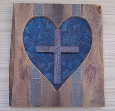 """This wall hanging heart cross is 100% hand crafted. The size of this piece is 22"""" H x 19"""" W. It is made from solid oak. This piece also has a patina metal insert. The cross that you see has also been handmade and given a patina finish. Each of these are one of a kind. These pieces are made right here in the United States.  Check us out at  www.ChristianArtisanCreations.com www.Etsy.com/shop/ChristianArtisanCrea"""