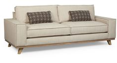 The angular Van Zandt Sofa is softened with standing French seam construction and tactile linen-look upholstery fabric. The coil spring cushions are wrapped in a down blend, and in addition the sofa comes with two down blend toss pillows. #austincollection #arthomefurnishings #sofa #couch #loveseat #organicliving #linencouch #linensofa