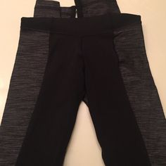Lululemon black pants Black and grey. Black strip in the front only. Grey all around. Worn few times. Slightly high waisted. Slight flare at the bottom. Price firm. lululemon athletica Pants