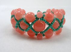 Handmade pink and green woven glass bead by ZoilaBelleCreations, $40.00