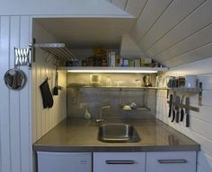 We thought our apartments were cramped until we saw this kitchen tucked into the stairwell nook of a Broome Street loft