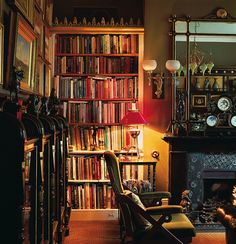 Books reside in bookcases (with Gothic cornice ornament) and in display cases in this home library in Great Britain. (Photo: Huntley Hedworth). I would really love to see the rest of this; the little that I do see is very breathtaking.
