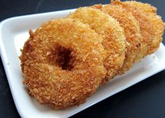 These crispy fruit fritters are coated with my current best friend, panko, those crunchy Japanese breadcrumbs and they are delicious! They can be served as is or topped with a scoop of vanilla or b… Beignets, Pineapple Fritters, Side Dishes For Ham, Eat Dessert First, Mets, Just Desserts, Dessert Recipes, Delish, Food And Drink