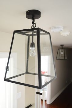 Three Oversized Lantern Lights For The Hallway Foyer Pendant Lighting, Hallway Lighting, Pendant Light Fixtures, Young House Love, World Market Lighting, Country Interior, Interior Lighting, New Homes, House Design