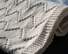 This blanket in this knitting pattern is the perfect gift to welcome a new life into the world. The pattern has a chart as well as written instructions. A larger version of the blanket will make an ideal housewarming or wedding gift. Baby Knitting Patterns, Lace Knitting, Knitting Stitches, Baby Patterns, Crochet Patterns, Blanket Patterns, Cotton Baby Blankets, Knitted Baby Blankets, Easy Knit Baby Blanket