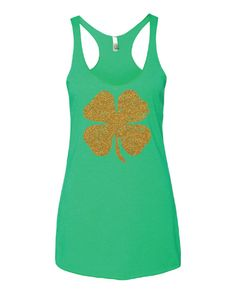 Shamrock. Shamrock Tank. Shamrock Shirt. Shamrock Tee. St. Patricks Day. Holiday Tanks. Holiday Shirts. St. Patricks Day Tank Top. Green.  St. Patricks Day Shamrock Racerback Tank Next Level Apparel brand Womens fit, 4.2 oz triblend racerback tank 50% Polyester, 25% Combed ringspun cotton, 25% Rayon Professionally screen printed.  Care Instructions: This item may be machine washed, but we recommend line drying to preserve garment.  Sizing: This product runs true to size, but there is a…