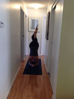 Yoga in small spaces.  Headstand variation