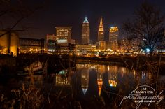 Night reflected_he lighted skyline of Cleveland, Ohio as reflected in the Cuyahoga River. 2012 At Land's End Photography, LLC — in Cleveland.