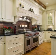 Brick backsplash and white cabinets