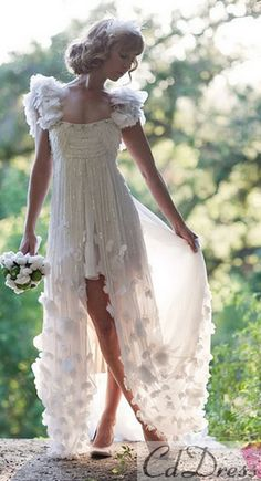 I wouldn't wear this. But I think it's beautiful! Like something out of a fairytale :) might be super cute for a beach wedding
