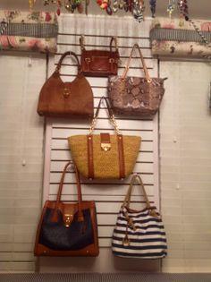 Closet slat board to hang purses.