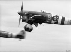 Wing Commander R E P Brooker, the No. 123 Wing Leader, takes off from Thorney Island, Hampshire, in his Hawker Typhoon Mark IB, MN570 'B', with seven more Typhoons of No. 198 Squadron RAF, on a sortie over the Normandy beachhead. They attacked and destroyed several German armoured vehicles on the Caen-Falaise road