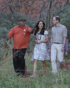 Catherine, Duchess of Cambridge and Prince William, Duke of Cambridge are guided by Sammy Wilson left, along the Kuniya walk at Uluru on Apr...