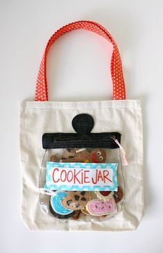 The Cookie Jar with felt cookies, added to a little tote bag :)  Not really a tutorial (and no patterns provided) but she explains how she constructed it, and links to another page with lots of instructions.  I'm sure I could figure out a pattern for cookies, considering how many I've eaten over the decades, LOL!